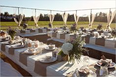 """white with burlap to cover the tables the food will be placed on...loving the neutral colors and the """"open-ceiling"""" tent"""