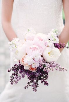 Brides.com: . New York City florist Blush Designs created this spring-inspired bouquet. Filled with white-and-blush peonies, fragrant lavender, and stock, this floral mix is filled with seasonable blooms.