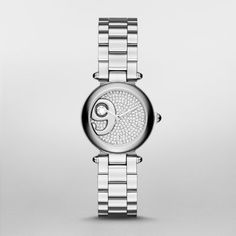 Dotty Stainless-Steel Three-Hand Watch An oversized polished nine o'clock index accented with a large crystal dominates the pavé crystal-studded dial of the Marc Jacobs Dotty watch. A stainless-steel case and bracelet with rounded links complete the look.