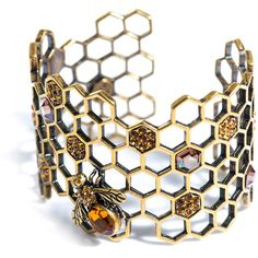 Alexander McQueen Honeycomb-bee topaz cuff (1.980 BRL) ❤ liked on Polyvore featuring jewelry, bracelets, accessories, alexander mcqueen, cuff, cuff jewelry, honey bee comb, honey comb, alexander mcqueen bangle and bumble bee jewelry