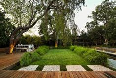 Eckersley's Modern Deck Garden- like the low deck, squares and tree coming through
