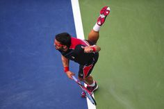Janko Tipsarevic serves against David Ferrer on Day 8 at the 2013 US Open