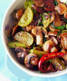Green Tomatoes and Mushrooms: Tart green tomatoes and earthy mushrooms stir fried in fragrant sesame oil.