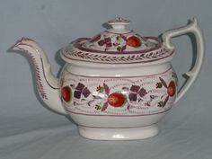 A London shape porcelain teapot and cover. Decorated with strawberry vines and pink lustre leaves. Standard size for this London shape and design. Some rubbing to painted decoration and lustres.some specks of brown staining in the glaze. |c.1820-30