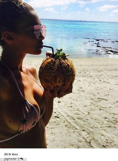Beach babe: Model Gigi Hadid showed off her curves in a tiny pink bikini as she sipped on a coconut in an Instagram photo she shared on Monday