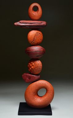 """Red Sky - Totem Series  -- by Ed Byers  Holden McCurry.  American Crafts Council artists.  Hand built terra cotta sculpture on steel base.  Multiple-fired  elements with glazes, terra sigillatas, slips, and oxide washes.26.5"""" x 10"""" x 8""""   $1,800."""