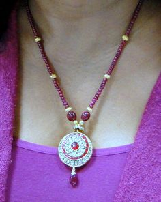 I'd love a long strand of rubies like this with no medallion.