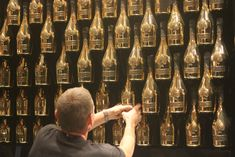 Image result for champagne bottle display wall