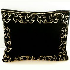 Black and gold embroidered purse