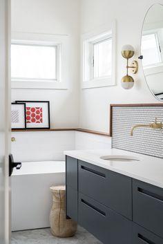 modern farmhouse bathroom with metallic fixtures