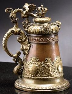 "Archduke Franz Ferdinand of Austria (1863 to 1914) copper tankard elaborately decorated with brass, the ear form handle surmounted by a winged eagle, the hinged cover embellished with four masks and capped by a crown finial, the body engraved ""Konopischt"" and decorated with an elaborate repousse band engraved four times with Ferdinand's cipher. Konopischt was Franz Ferdinand's favorite castle and hunting retreat located in Bohemia (now Czech Republic)"