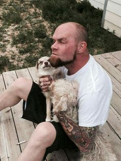 Ivan Moody with a puppy. This makes my heart melt to water, I swear