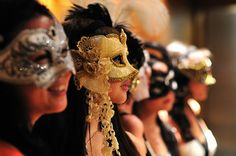 Have/Attend a masquerade ball.