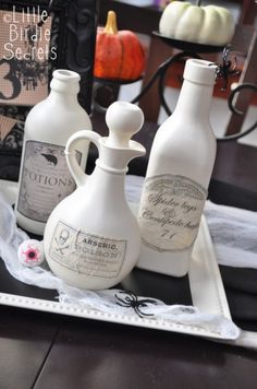 Aged Halloween Potion Bottle Labels by Little Birdies at Make and Takes- These labels are a great way to reuse old jars as Halloween decor for a party or mantle.
