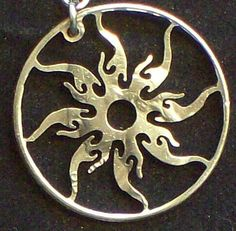 Sun Earrings Hand Cut Coin Jewelry    Reminds me of Tangled