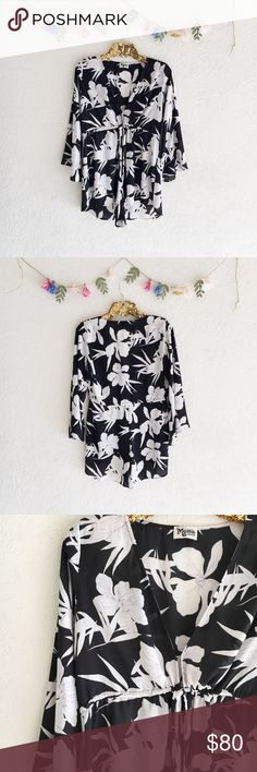Show Me Your Mumu Roxy Romper - Lily Collins This floral Mu has got the black as ebony and white as snow thing covered for that romantic cool girl look you've been craving.  The Roxy Romper is a feisty girl who has mastered the art of the class and sass. She knows just how low she can go to keep you feeling hott and sophisticated all at the same time. She has a waist-tie to make sure she fits you perfectly.   *100% Poly  *Ties around waist  *Hook & eye in front  *Basically Wrinkle-proof…