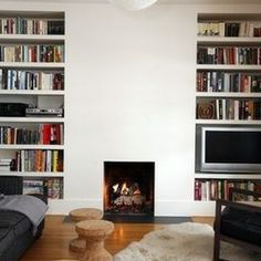 Pop out the fireplace and tile with large grey tiles. Have bookshelves built to fit into surrounding fire. Bookshelf Styling, Built In Bookcase, Bookshelves, Fireplace Bookcase, Fireplace Mantles, Condo Decorating, Decorating Ideas, Decor Ideas, Home Libraries