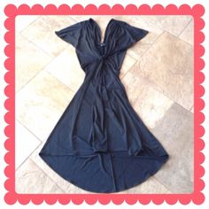 ☀️Host Pick☀️ Sexy Black Dress 🔷BUNDLE & SAVE 30%🔷   Black dress with plunging neckline in the front and diamond shape cut-out to expose some of your back. This falls below the knee and has gathers at short, flowy sleeves. This dress was hard to get good pics of. NWOT!!! MODA International Dresses