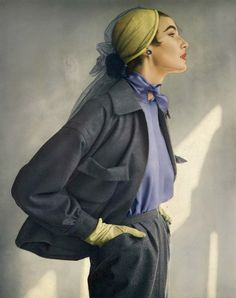 1950 Model in gray Worumbo flannel suit over China blue blouse accented with hints of yellow in the gloves and hat, by Christian Dior-New York,