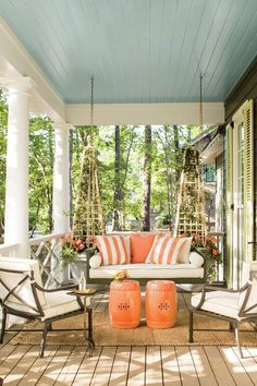 """The Exterior - The 2016 Idea House - Southernliving. """"When we settled on this corner property,it begged for a wraparound porch that faced both streets,"""" says Ingram about his Southern raised cottage.A relaxing side porch opens off the living room. We love the contrasting colors of blue and orange - cretes a dramatic look! www.ellesvision.com/ #JAX"""