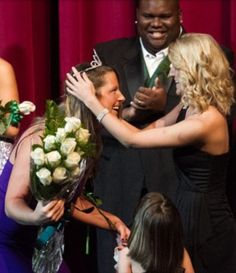 Phi Phi's Candace Boeh is crowned homecoming queen by her sister and the previous year's homecoming queen, Katie Bridges. The four-point crown represents leadership attained and the name of recognition given to our alumnae.