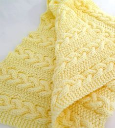 Knitting Pattern for Reversible Rapunzel's Surprise Cable Baby Blanket - Completely reversible braided cable blanket in three sizes. Quick knit in chunky yarn.
