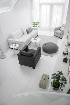 Light grey and white living room via Nordic Days.