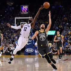 Golden State Warriors' Stephen Curry (30) and Memphis Grizzlies' Tyreke Evans (12) reach for a ball during the second quarter of their NBA game at the Oracle Arena in Oakland, Calif., on Saturday, Dec. 30, 2017. (Jose Carlos Fajardo/Bay Area News Group)