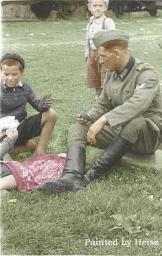German soldier plays with the Russian boys