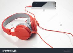 Red Headphone Connecting With Smartphone On White Background Table Stock Photo 323622557 : Shutterstock