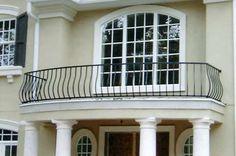 Simple black wrought iron balcony railing looks really good here