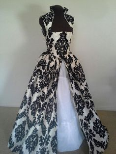 You will be stunning in this brand newly made renaissance over gown! The dress is a creamy off-white taffeta flocked with a soft, velvety black