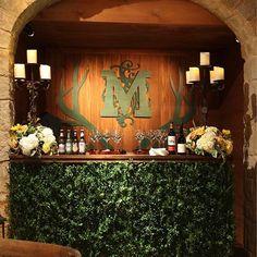 We love these hedge bars with custom monogrammed bar-backs. .  @samuelgranadophoto . . . #jacksondurhamevents #eventdesign #eventdecor #hedgebar #boxwoodbar #floraldesign #party #tentedparty #skilodge #germanbiergarten