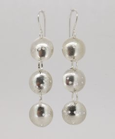 """""""Domino domes"""" - these stunning sterling silver earrings feature three domes (10mm diameter) and have a total drop of 50mm. Add them to your collection now for just $75(AUD) from mhoriginals.com.au ❤"""