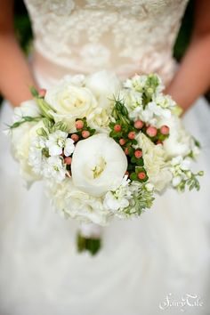 Red berries bring the perfect splash of color to this white peony bouquet   Fairy Tale Photography