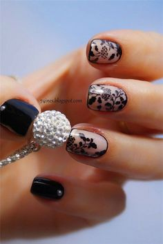 Floral design black polish nail art design and clear coat. Frame your nails in beautiful floral nail art design against a clear nail polish to create that painting effect on your nails.