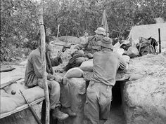 Vietnam War Combat | Weary looking members of 3RAR, their weapons close at hand, take time ...