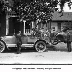 Grinnell Motor Company, Tow Truck, with disabled automobile, 1920