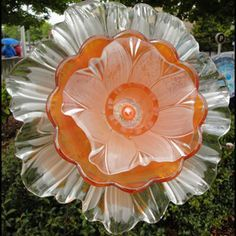Everblooming Glass Flowers by Sandy Dahlberg - uses hinged stems so can be converted into bird feeders or baths