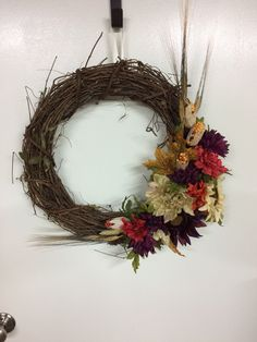 A personal favorite from my Etsy shop https://www.etsy.com/listing/466384276/16-grapevine-wreath-purple-orange-and