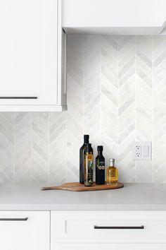 Modern look elegant marble mosaic tile for remodeling projects. Kitchen Splashback Tiles, Backsplash Tile, Herringbone Backsplash, Backsplash Ideas For Kitchen, Kitchen Backplash, Backsplash Panels, Kitchen Fixtures, Kitchen Cabinet Design, Modern Kitchen Design