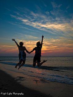 Summertime, vacation, the beach, beautiful sunset... all good reasons to jump for joy!!!  Photo by David Howland,  Frigid Light Photography  www.frigidlight.com