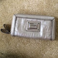 Nicole by Nicole Miller Wallet normal wear, some small stains. shiny cream color. lots of card holders Nicole by Nicole Miller Bags Wallets