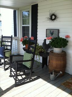 Hate to see the summer end! Country porch with rockers, barrels,and benches.