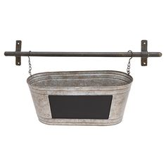 Showcasing a hanging design and weathered finish, this industrial-chic wall planter effortlessly doubles as a catch-all in the entryway or kitchen.