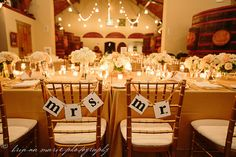 """Gold chairs with the """"Mrs."""" and """"Mr."""" lettering lends a bit of fun to the sophisticated décor."""
