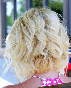 Angled Piecey Bob haircut, styled curly and super cute!