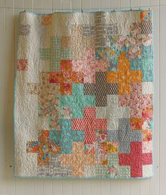 A modern quilt in all the soft warm colors of summer! This quilt is made from a top quality quilt shop collection of fabric called SummerLove.
