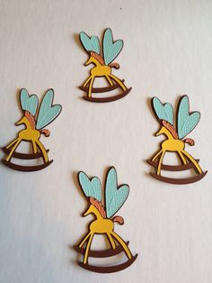* Easily made for wall accents. Alice in Wonderland Horse Flies 2. $1.75, via Etsy. - cute decoration!