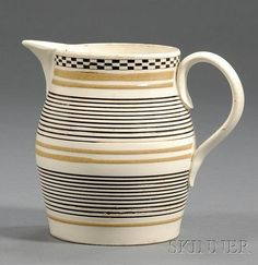 Small Engine-turned Mochaware Jug, Britain, c. 1790, baluster-form jug with rouletted black slip-filled checkered rim band over thin...